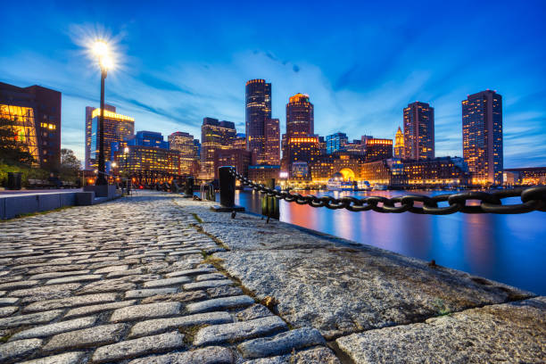 Boston Skyline with Financial District and Boston Harbor at Dusk, USA stock photo