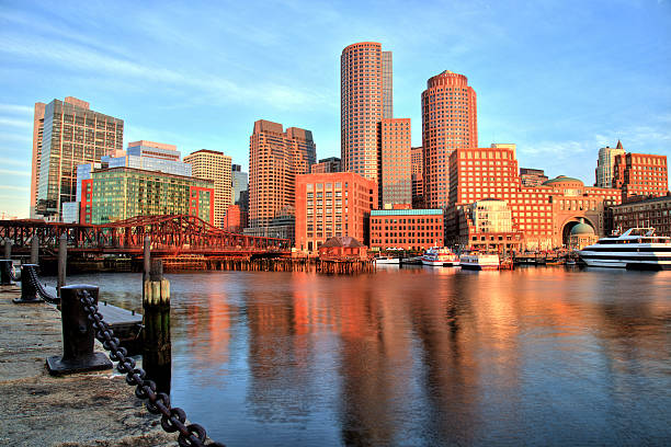 Boston Skyline with Financial District and Boston Harbor at Sunrise stock photo