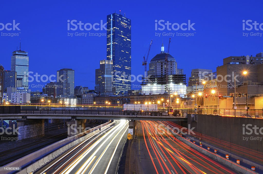 Boston streets and skyline at night stock photo