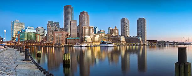 Boston Sunrise Under Clear Blue Sky and Calm Harbor Panorama stock photo