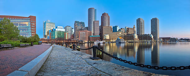 Boston Sunrise With Skyscrapers Reflecting in a Glassy Channel Panorama stock photo