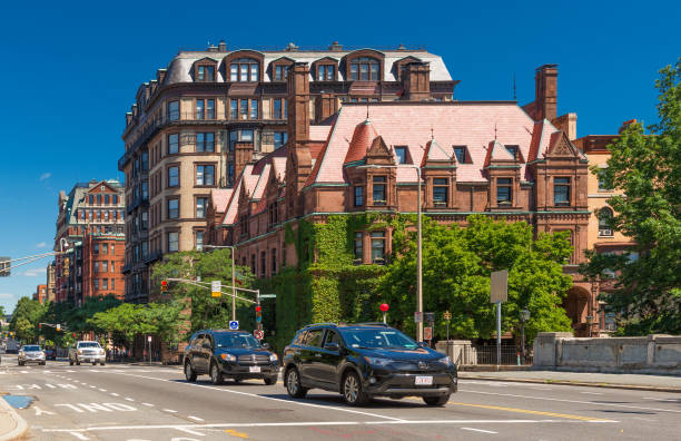 Boston, USA: Street view with historical houses made of brown stone and cars moving in Back Bay district of Boston stock photo