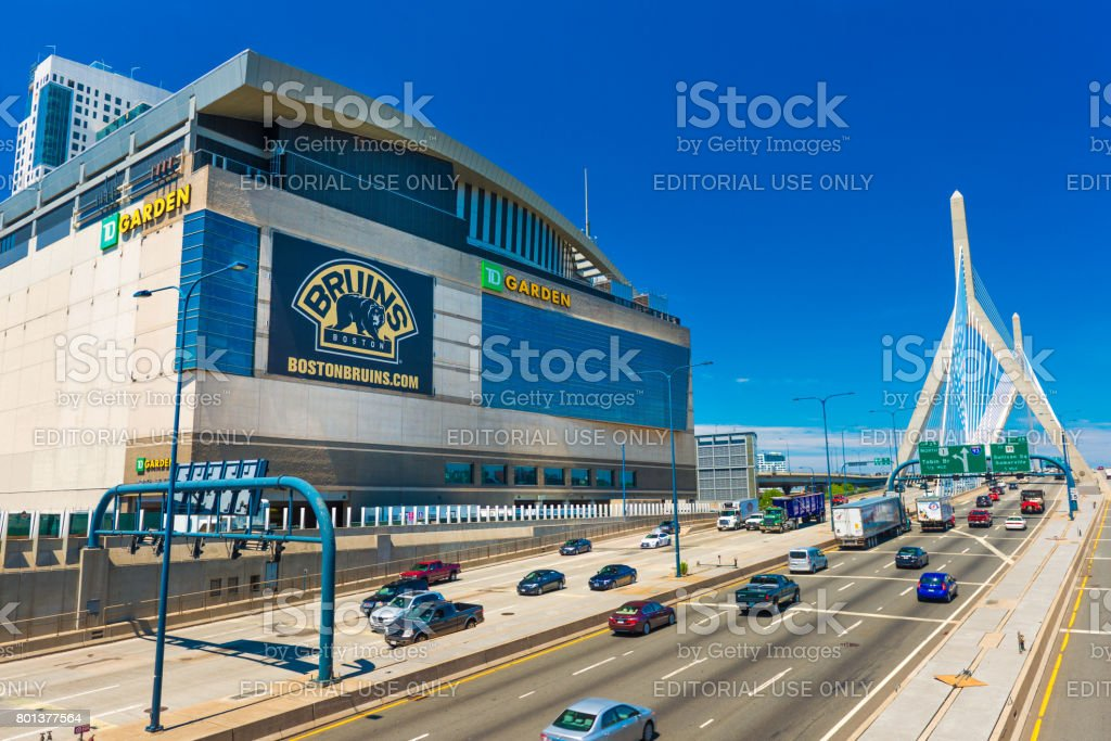 Boston, USA: View of TD Garden, Leonard P. Zakim Bunker Hill Bridge and highway with traffic in sunny summer day with clear blue sky stock photo
