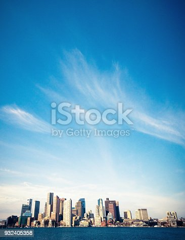 Wispy clouds above the waterfront cityscape of Boston, Massachusetts.