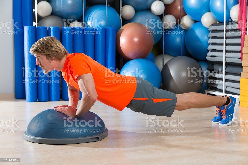 Bosu diamond push up blond man gym exercise stock photo