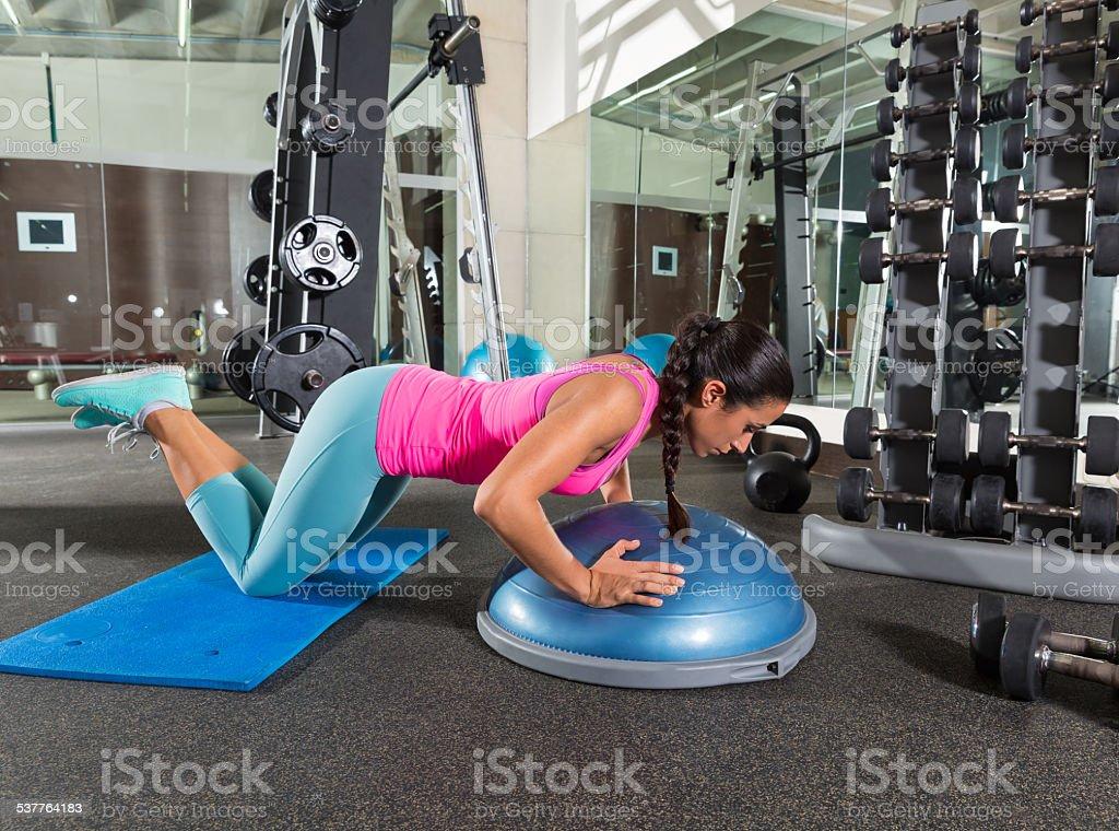 Bosu knees push up push-up woman at gym stock photo