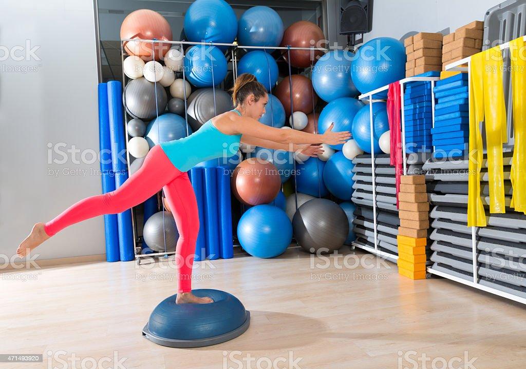 bosu one leg extension deadlift girl exercise stock photo