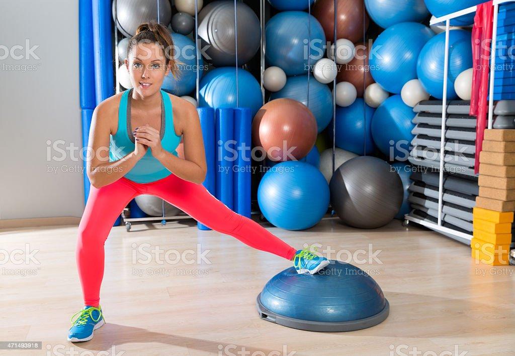 bosu one leg squat girl exercise at gym workout stock photo