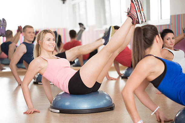 Bosu training in fitness club stock photo