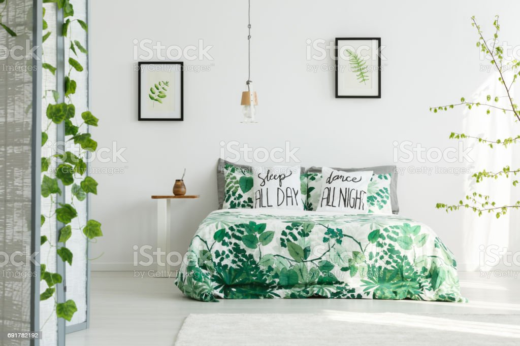 Botanical bedroom with white wall stock photo