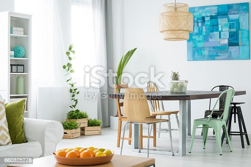 istock Botanical room with dining table 660325278