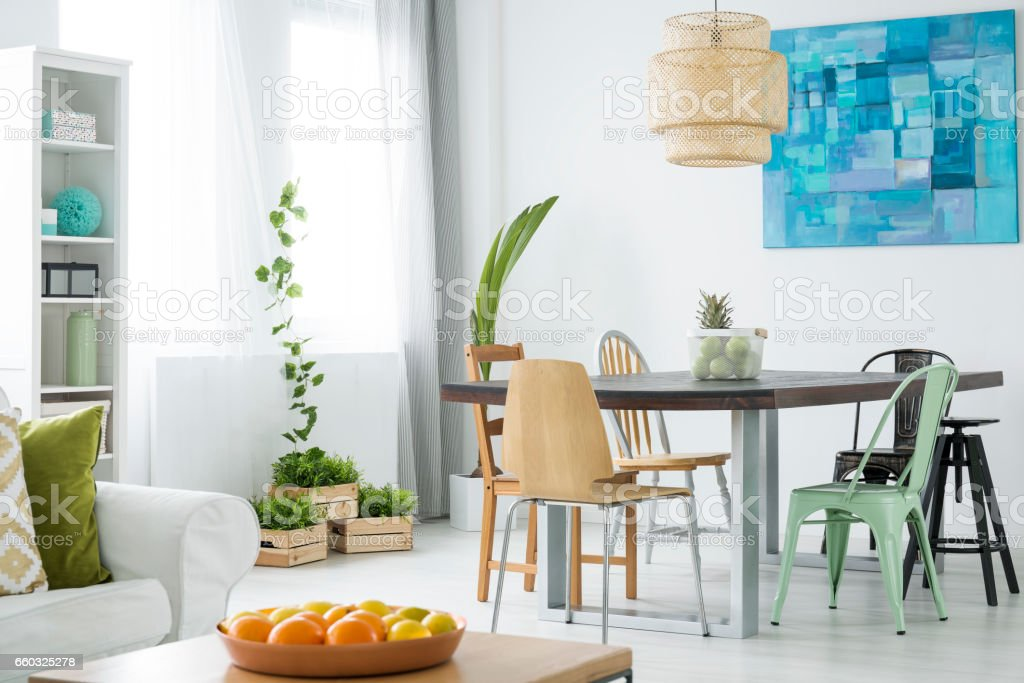Botanical room with dining table stock photo