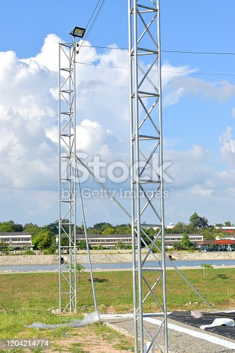 Both electric poles are located outdoors, behind the sky.