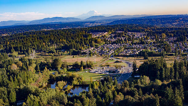 Bothell Mill Creek, Washington Suburbs Aerial - Mount Rainier Backdrop Bothell Mill Creek, Washington Suburban Forest Aerial - Mount Rainier and Cascade Mountains Backdrop pierce county washington state stock pictures, royalty-free photos & images