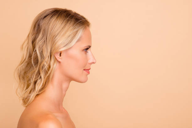 botox collagen detox advertising concept. profile side view portrait of her she attractive wavy-haired lady with pure clear clean flawless smooth skin copy space isolated over beige  background - capelli mossi foto e immagini stock