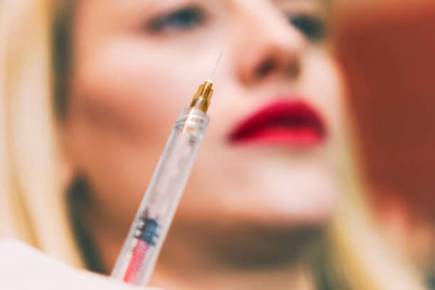 botox-spritze - nadeldesigns stock-fotos und bilder