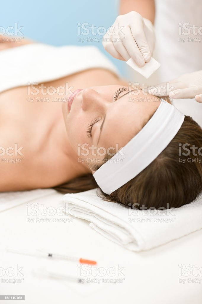 Botox injection - Woman in cosmetic medicine treatment royalty-free stock photo