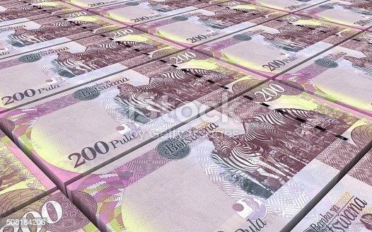 istock Botswana pula bills stacked background. 508184206