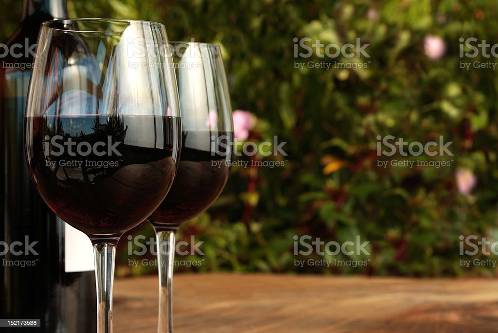 Bottle & Glasses of Red Wine in the Evening royalty-free stock photo