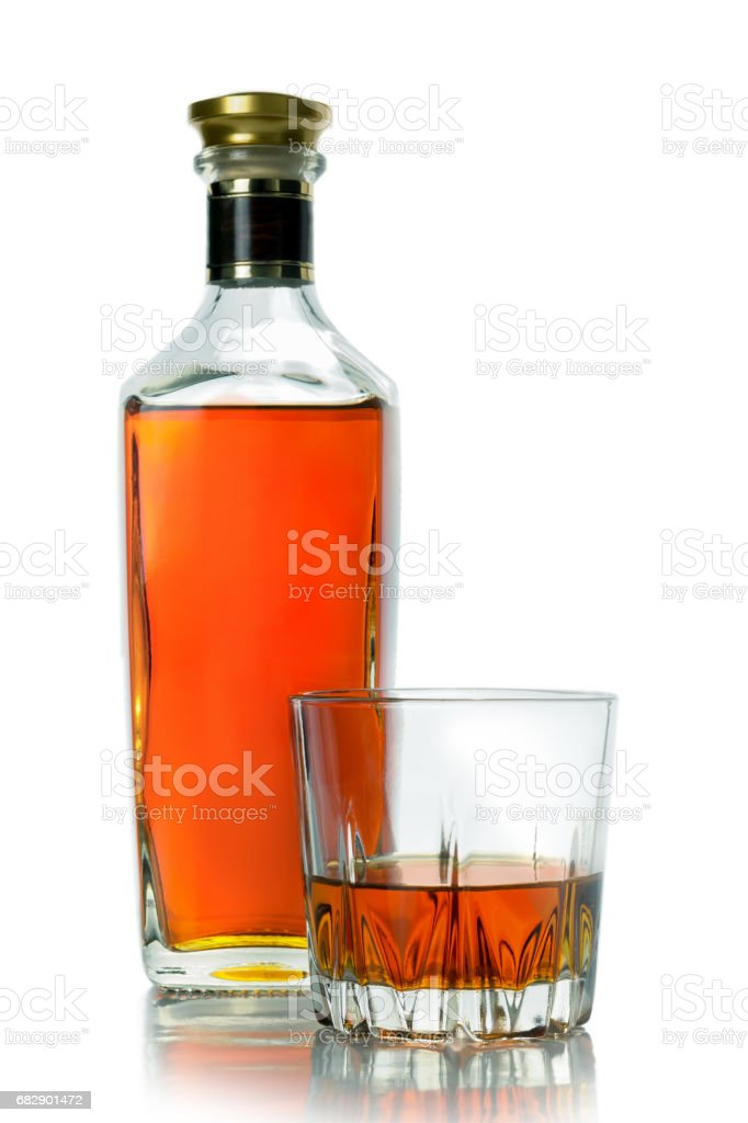Bottle and a glass of brandy stock photo