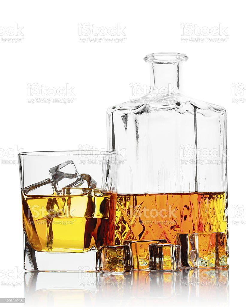 Bottle and a glass of whiskey with ice stock photo