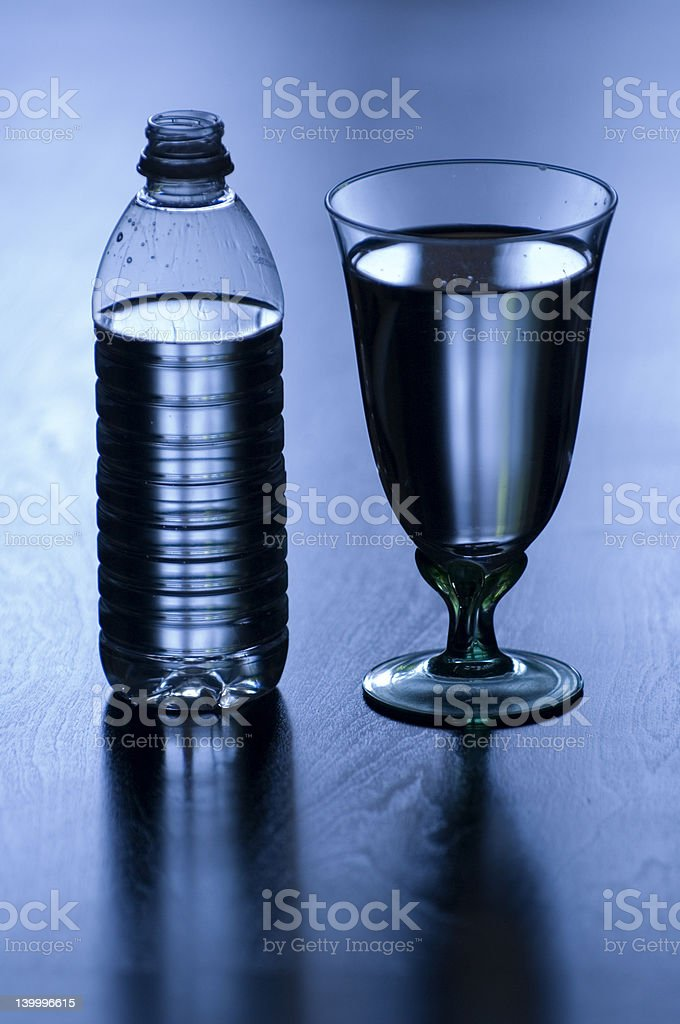 Bottle and cup of water stock photo