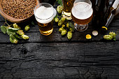 istock Bottle and Glass beer with Brewing ingredients. 1040641432
