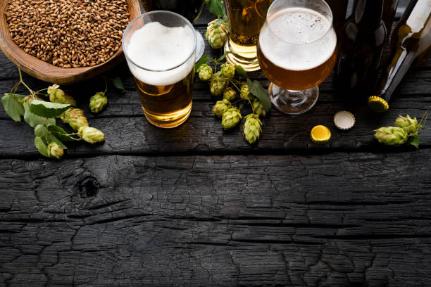 Bottle and Glass beer with Brewing ingredients. stock photo