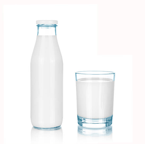 bottle and glass of milk - milk bottle stock photos and pictures