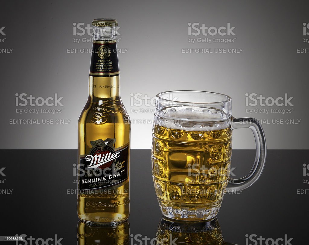 Bottle and Glass of Miller Beer stock photo