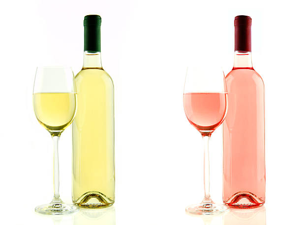 Bottle and glass of white and rose wine isolated stock photo