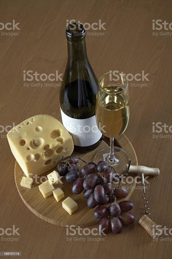Bottle and glass of white wine with cheese royalty-free stock photo