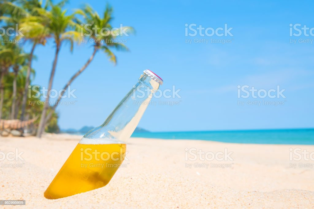 bottle beer on sandy beach stock photo