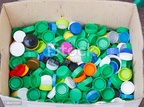 Bottle Cap, made of Polypropylene and Polyethylene Plastic Resin, do not biodegrade. If not recycled, these caps pose danger to marine life because of small size. Environmental Protection Care concept