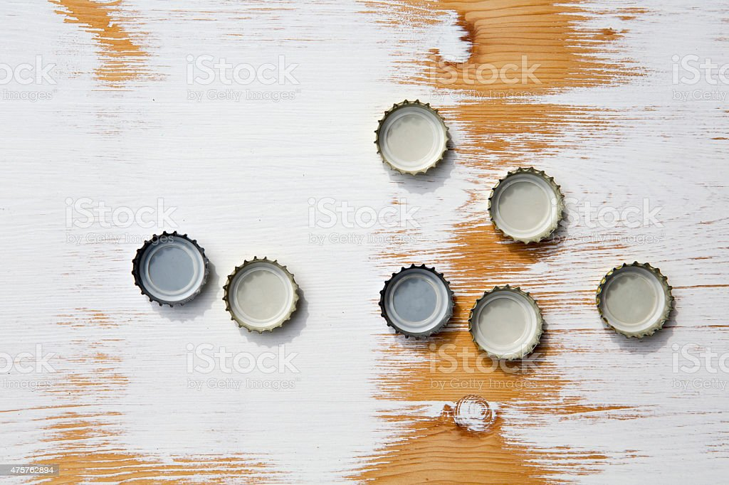 bottle cap on rustic wooden background stock photo