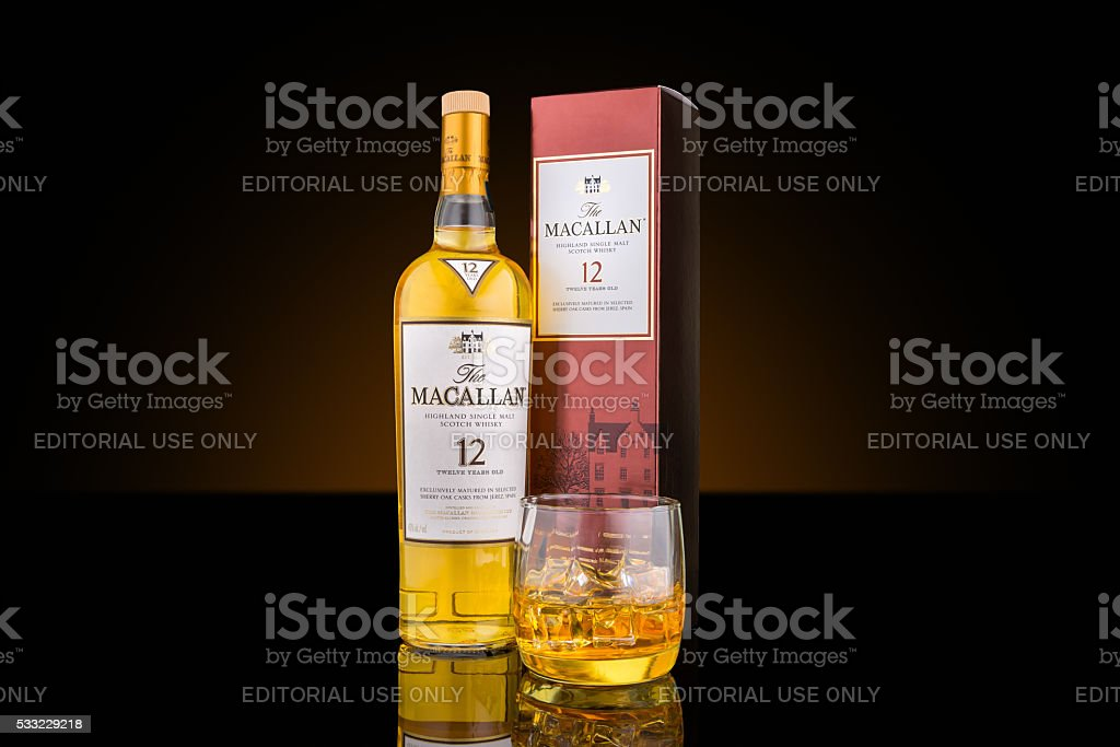 Bottle, case and glass of Macallan single malt whisky stock photo