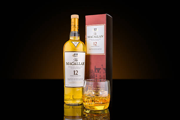 Bottle, case and glass of Macallan single malt whisky