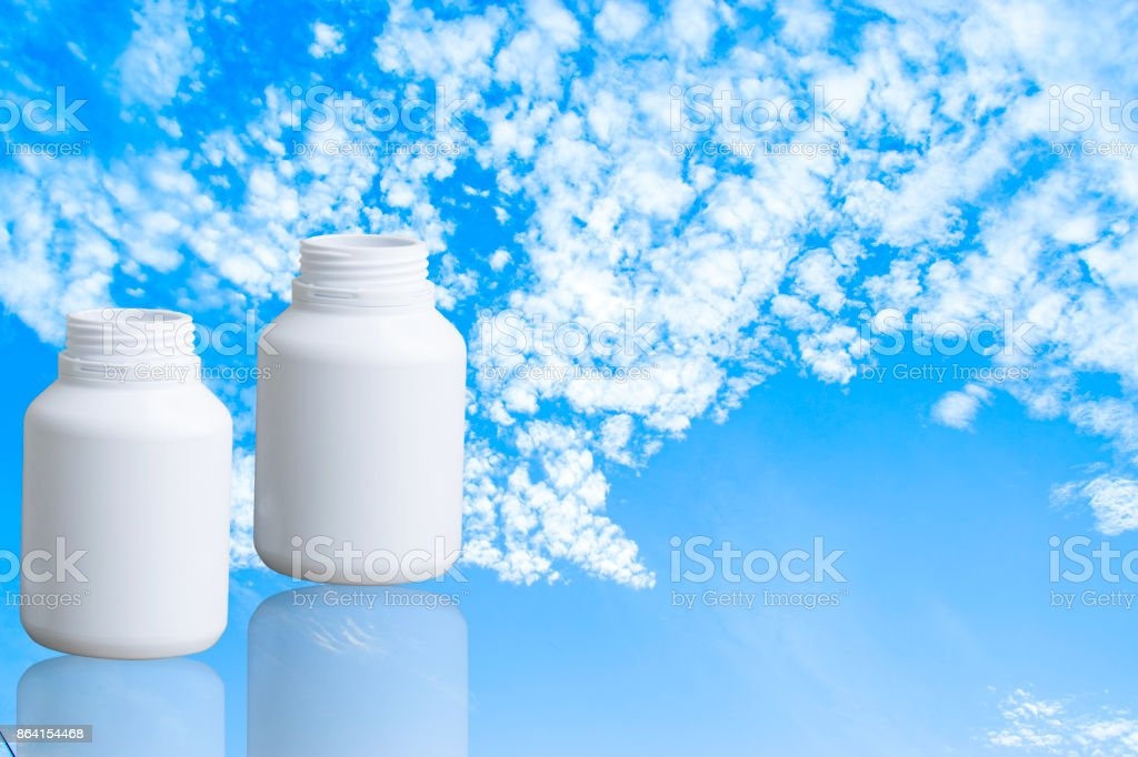 Bottle drug made to plastic on isolated background.Using wallpaper for package or product, drug image and copy space royalty-free stock photo
