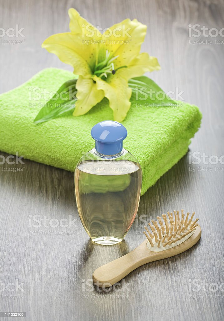 bottle hairbrush towel and flower royalty-free stock photo