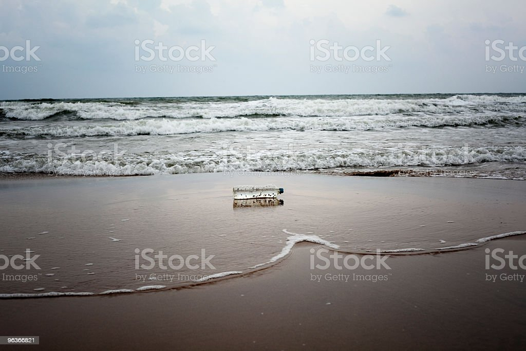 bottle in the beach royalty-free stock photo