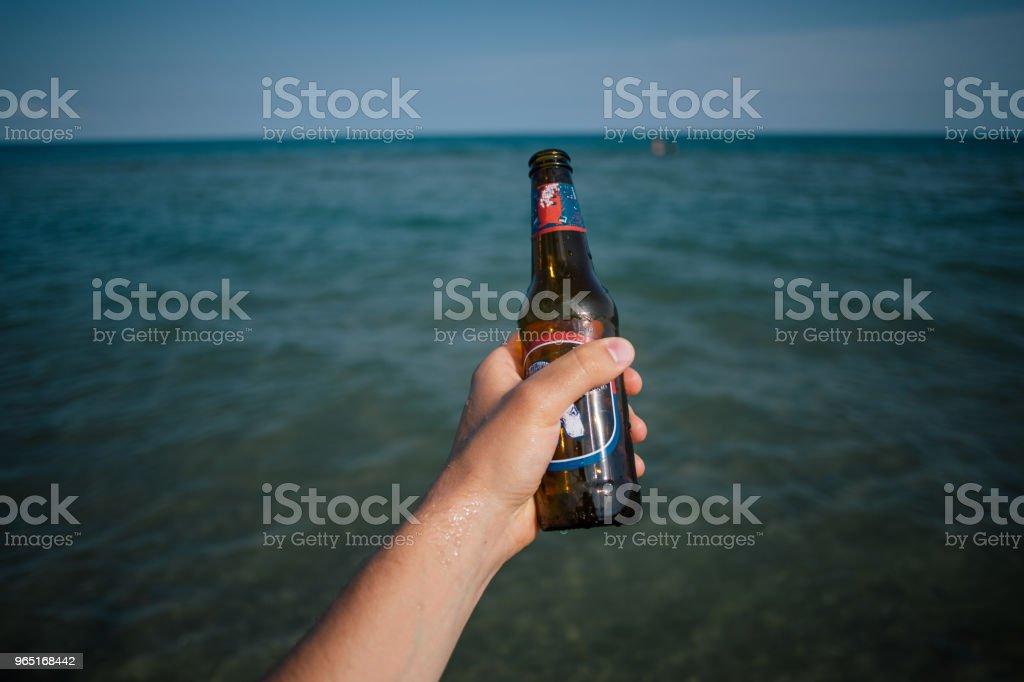 Bottle in the hand sea in Italy apulia zbiór zdjęć royalty-free