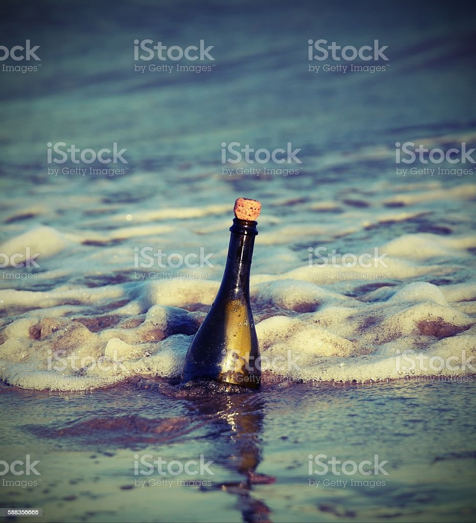 bottle in the ocean with a secret message 4 stock photo