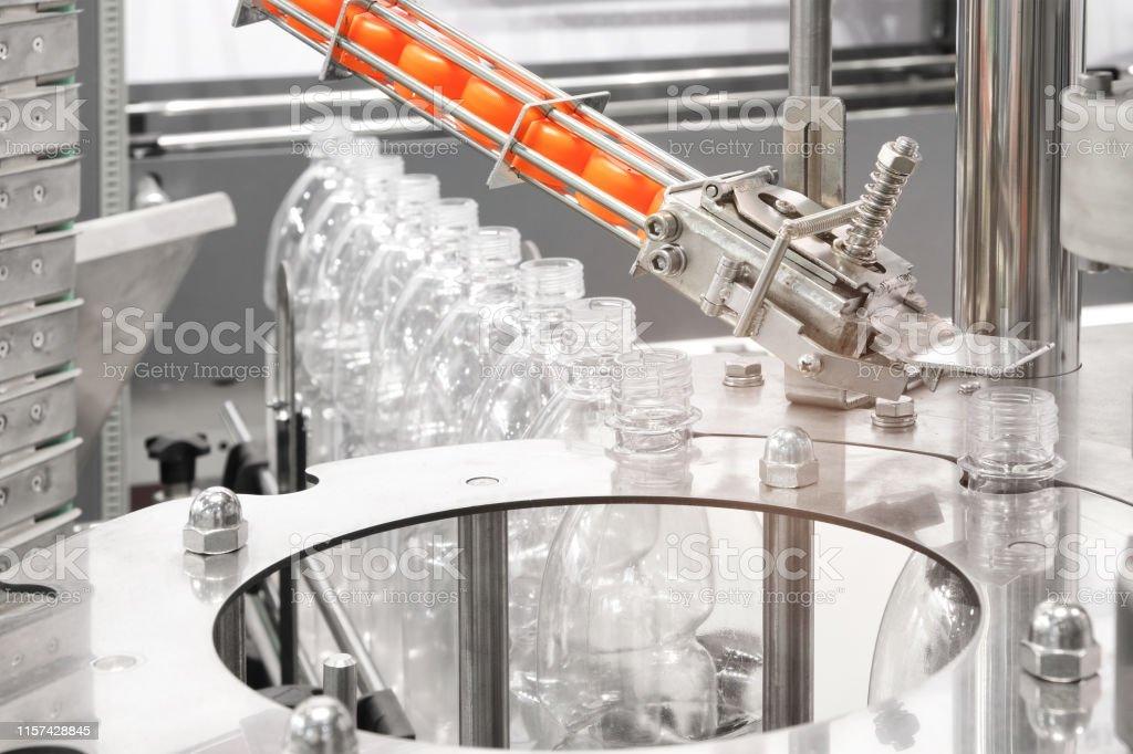 Bottle. Industrial production of plastic pet bottles. Factory line...