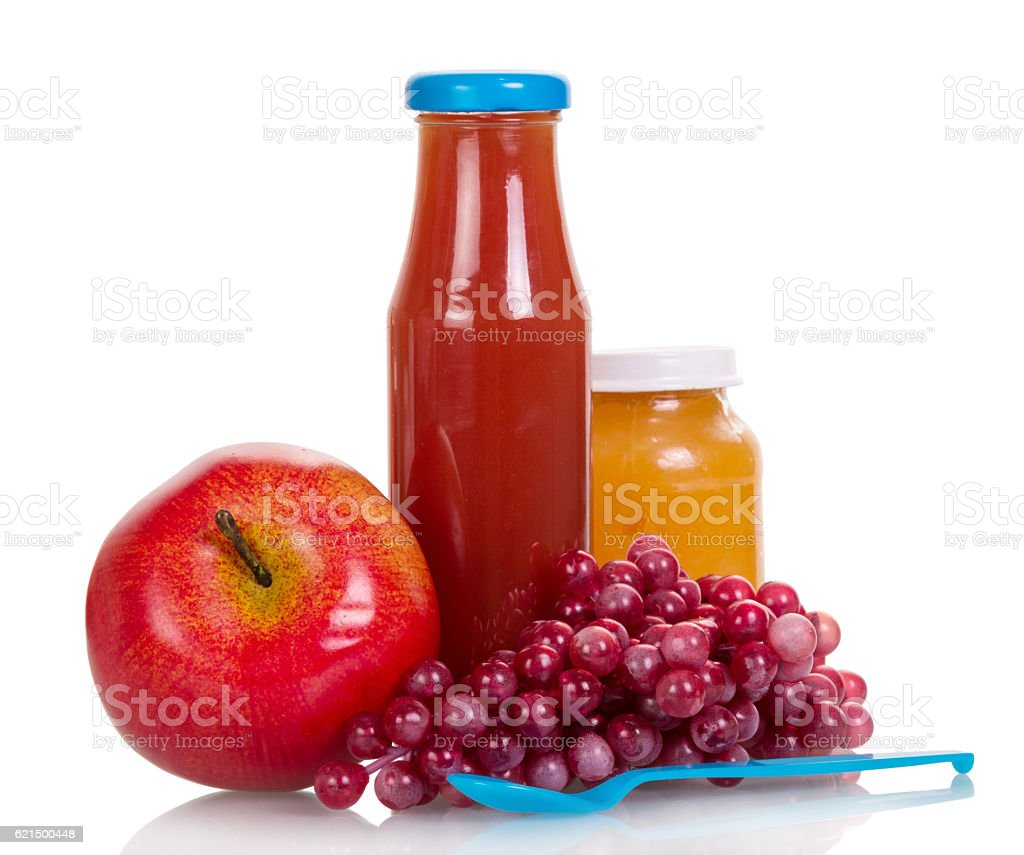 Bottle juice, grapes, jar fruit puree, apple and spoon isolated. Lizenzfreies stock-foto
