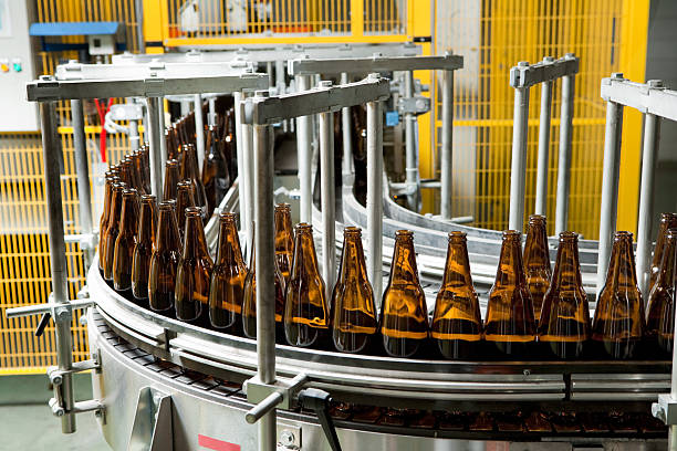 bottle manufacturing - bottling plant stock photos and pictures