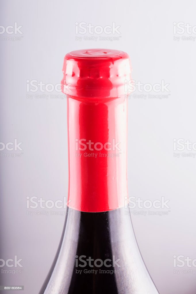 Bottle neck with red cap, vertical image