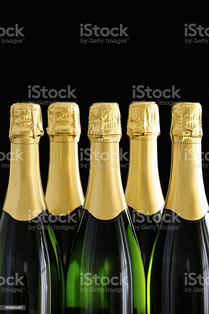 Bottle necks of Champagne bottles on black background stock photo