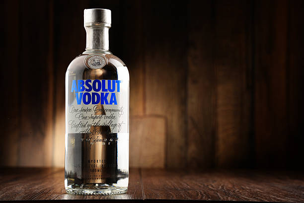 Bottle of Absolut Vodka Poznan, Poland - June 22, 2016: Absolut Vodka is a brand of vodka, produced near Ahus, in Sweden. Owned by French group Pernod Ricard it is one of the largest brand of alcoholic spirits in the world. vodka stock pictures, royalty-free photos & images