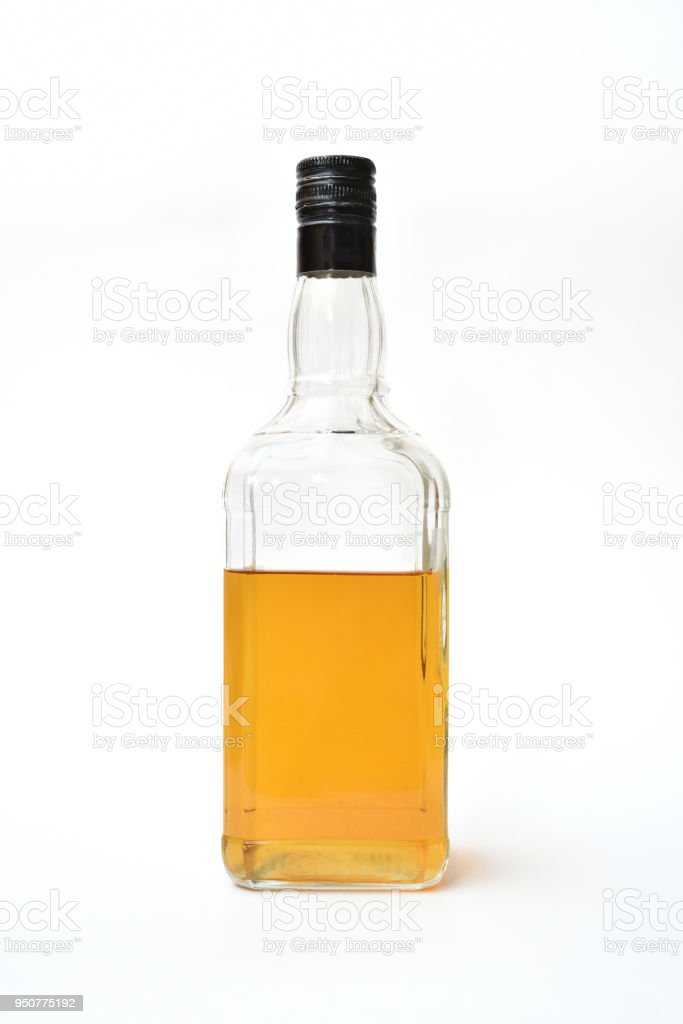 Bottle of alcohol, started. Half-empty bottle with alcohol on a white background stock photo
