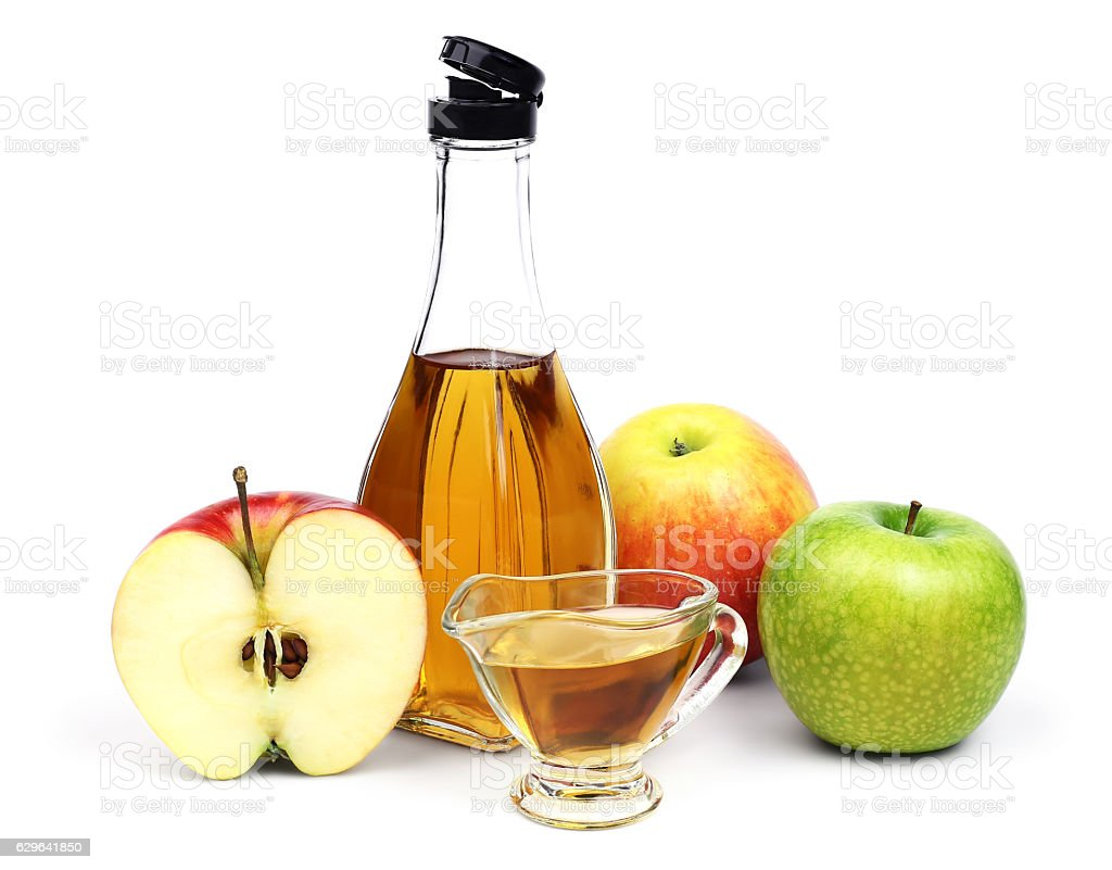Bottle of Apple cider vinegar and apples. stock photo